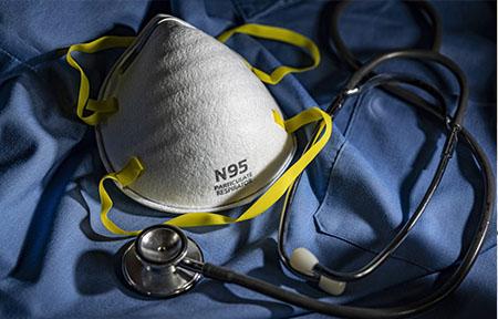 N95 mask, scrubs and stethoscope